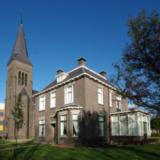 Kerkgebouw en pastorie - ontwerper onbekend